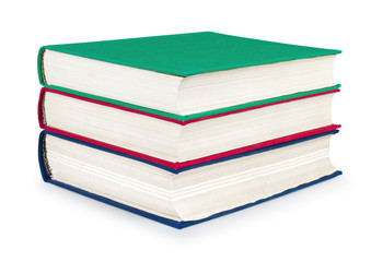 stack of vintage red, green and blue books on white isolation