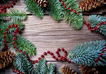 Christmas background with a red ornament and fir
