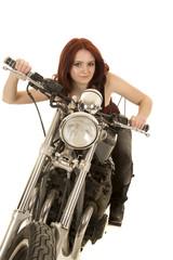 woman red hair motorcycle lean forward