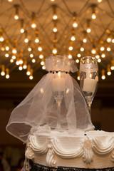 Champagne glasses decoration on wedding cake