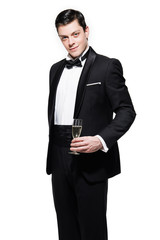 New year's eve fashion man wearing black dinner jacket. Holding