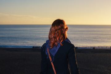 Woman admiting the sea at sunset