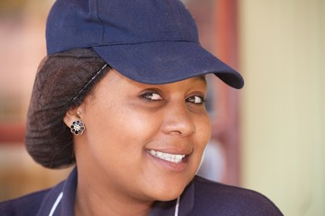Cheerful seller portrait in uniform