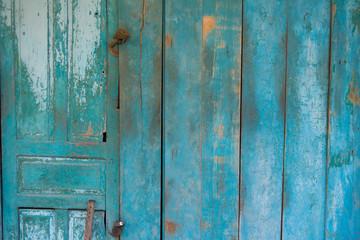 Blue weathered wooden door with rusty lock