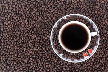 cup of coffee with heart on the background of coffee