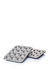 Cupcake tin pan over white background