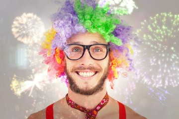 Geeky hipster in afro rainbow wig