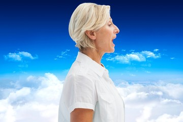 Composite image of happy mature woman talking loudly