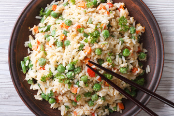 Asian fried rice with egg and vegetables top view horizontal