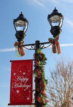 Happy Holidays Banner attached to replica antique light pole