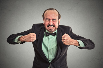 Angry frustrated man screaming isolated grey background