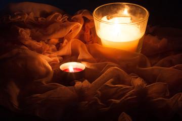 Candles naturmort in dark on pink drape