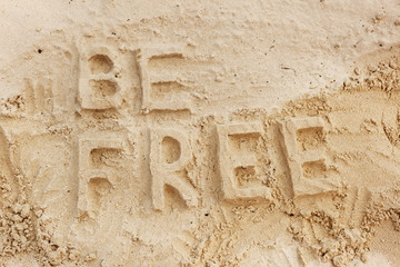 """the phrase """"be free"""" in the sand"""