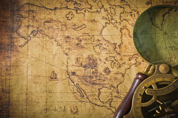 old map with compass and Magnifier