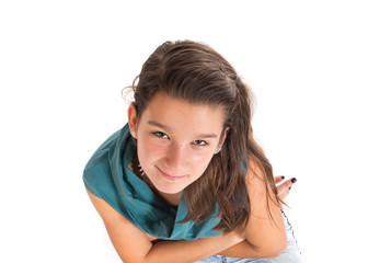 Girl with her arms crossed over white background