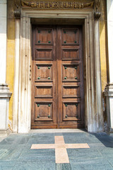 door   in italy    the milano old   church   closed brick  pavem