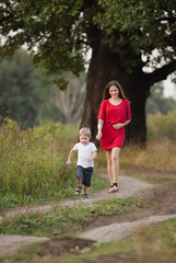 mother and son walking by the road  in countryside