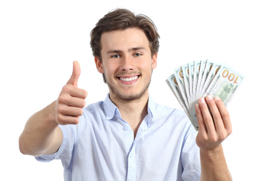 Young man holding money with thumbs up