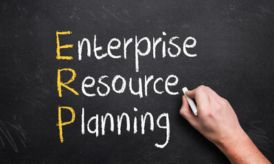 hand writing enterprise resource planning on a chalk board