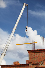 Construction crane against blue sky