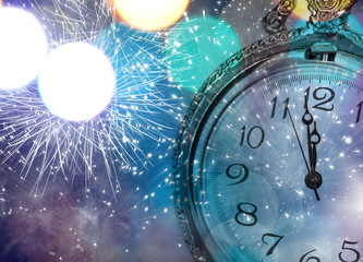 Vintageclock with fireworks and holiday lights