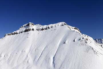 Snowy rocks in sun day