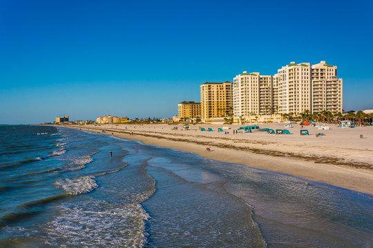 View of beachfront hotels and the beach from the fishing pier in