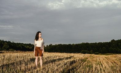 young beautiful free woman in field