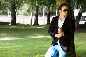 Fashion model wearing a blazer and jeans