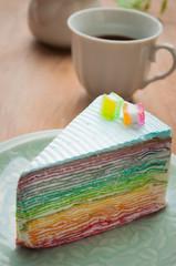 Rainbow crape cake on plate. (Selective Focus)