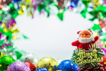 Santa claus dall and Christmas ornaments background