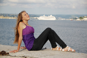 beautiful  girl and a cruise ship