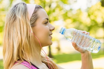 Fit blonde drinking from her water bottle