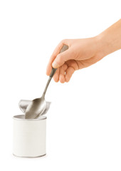 hand holding a spoon in a tin on a white background