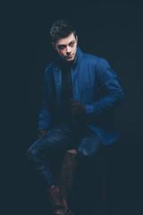 Winter jeans fashion man with short dark hair. Wearing blue jean