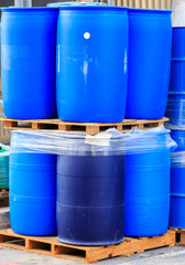 Blue plastic barrels on paletts
