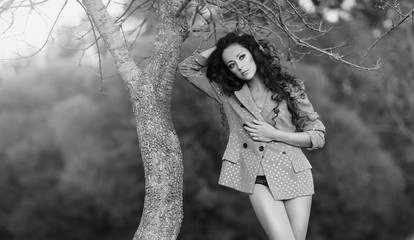 Black and white photo of a beautiful model with long hair