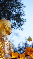 golden monk statue in thailand