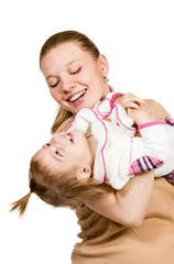 Mom holds the child in her arms and plays
