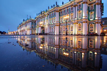 Russia, St. Petersburg, Hermitage buildings reflected in water,