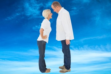 Composite image of angry older couple arguing with each other