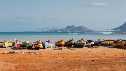 Fishing boats rest in Mindelo beach.