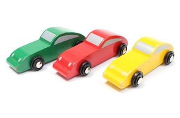 Colorful old toy cars isolated on white background