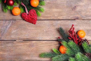 Fresh ripe mandarins, Christmas decorations and fir tree bud