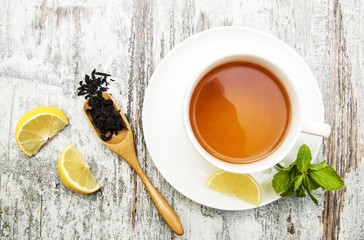 Wall Mural - Cup of tea with lemon and mint