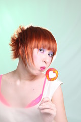 redhead girl with lollipop heart vertically