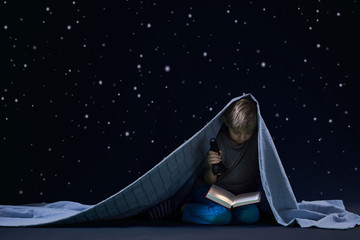 Reading under the blanket