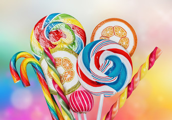 Colorful candies and sweets on a multi-colored background