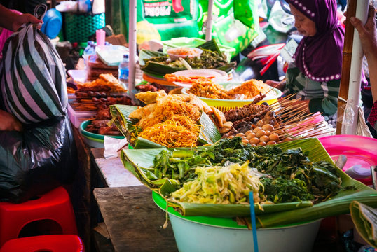 Woman selling food at local food market, Indonesia