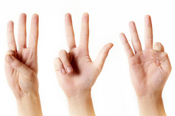 Male hand showing three fingers on white background